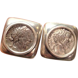 Silver coufflings set with antique Silver Roman coins.