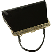 1960s Vintage Black Patent Handbag with Embossed Silvertone Frame by J Rudolph