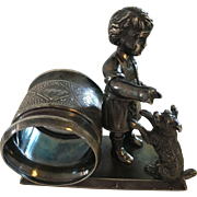 "Silver Napkin Ring - ""Boy Teaching His Dog Tricks"""