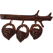 Vintage folk art pin, carved peach pit baskets on twig