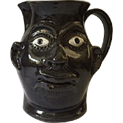 Contemporary folk art face jug in a rare pitcher form, South Carolina drip glaze pottery