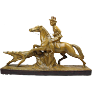French Art Deco sculpture of a hunting scene, Figure of a hunter on his horse with two dogs, 1920's plaster statue figurine marked '218 - Decora - Depose'