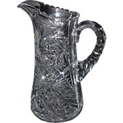 "Lot #726 - Cut Glass Pitcher - Hobstar/Fan/Pinwheel Pattern - 9"" Tall"