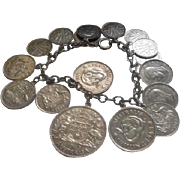 "Silver Link Bracelet w/ (17) Silver Coin Charms - 7"" Long - 57.6 grams"