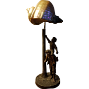 Antique Figural Lamp with Nautilus Shell Shade