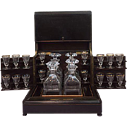 Napoleon III bois noirci liqueur cellar with brass inlays - complete interior with 4 carafes and 16 partly gilt glasses - France - circa 1880