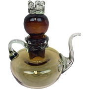 An antique mouth blown oil jug