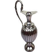Silver plated water can with grip in shape of a dragon - England - first half 20th century