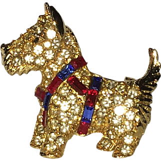 Scottie dog pin with clear, red, and blue rhinestones, signed MBB/BELL