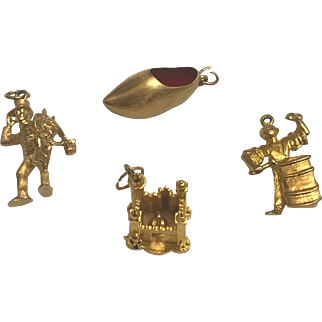 Four Assorted Vintage 3D 14K Travel Charms 16.2grams
