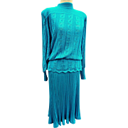 Pretty 1970's vintage knitted skirt suit by oliver james for Frank Usher,  jade green woven and crocheted wool two piece,