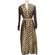 A stunning and opulent 1960's maxi cocktail evening dress in brown and gold