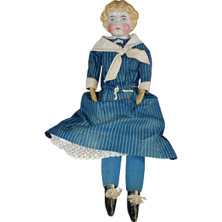 "24"" Kling #189 German china head doll."