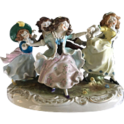 19th Century Dresden Hand Sculpted and Painted Ring Around The Rosie Figure Signed Zoli