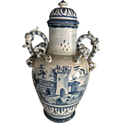 A Dutch Delft blue and white chinoiserie large vase dated 1710