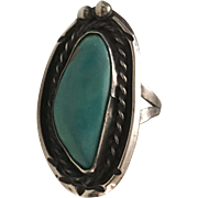 Vintage Native American Hand Crafted unmarked Silver Ring with turquoise center stone