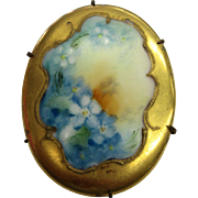 Hand painted Porcelain Oval Brooch with Lovely Blue Flowers and Gold border
