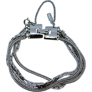1970's MONET Silvertone Multi-chain Bracelet with Safety Chain.