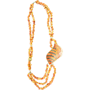 Vintage Orange Coral Necklace with Conch Shell Motif.