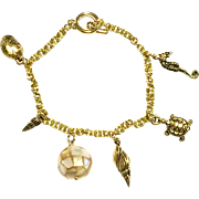 Ocean Themed Charm Bracelet with Gold Mother Of Pearl Ball