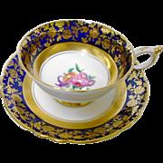 Paragon golden floral motif cobalt teacup duo