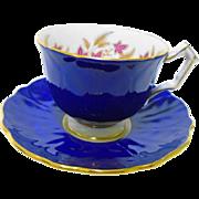 Aynsley cobalt blue textured crocus tea cup and saucer, pink flower teacup