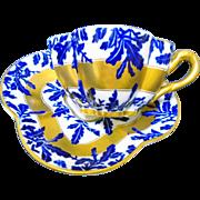 Coalport demi flow blue teacup duo, solid gold band quatrefoil