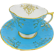 Aynsley turquoise & gold tea cup and saucer, dainty quatrefoil teacup