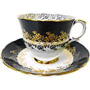 Crown Staffordshire golden rose black tea cup and saucer