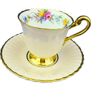 Paragon rose gold peach demitasse cup and saucer
