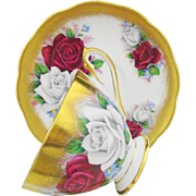 Queen Anne Large roses heavy Gold tea cup and saucer