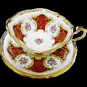 Paragon Pink rose cartouche gold tea cup and saucer