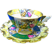 Castle Japan 3 footed FISH handle tea cup and saucer