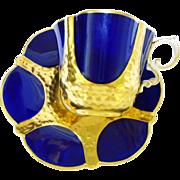 Aynsley cobalt gold tea cup and saucer, textured quatrefoil
