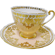 Shelley Ripon Gold pastel peach tea cup and saucer
