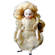 A Stunning All Bisque Doll with Mohair Wig & Lace Dress