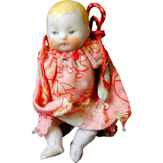 A Sweet All Bisque Articulated Baby Doll ' German'