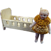 A Tiny Carl Horn Bisque Doll & Cot C.1910