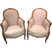 Vintage pair of French Louis XV style upholstered armchairs or bergeres, circa 1900