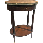 Vintage French mahogany oval side table with leather top, circa 1960