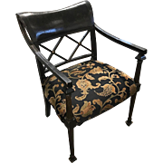 Antique English Regency armchair with lacquered Oriental motifs.