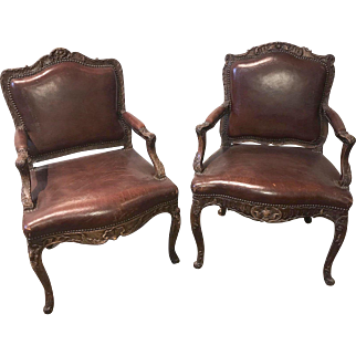 19th century pair of French Regence walnut and leather armchairs, circa 1830