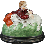 European Porcelain Hinged Bonbonnierre or Trinket Box Featuring a Figural Piping Shepherd with Sheep and Dog