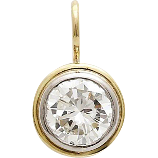 A Dazzling Vintage Round Diamond Solitaire Pendant Set In 14KT Yellow Gold