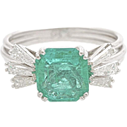 A Large Emerald and Diamond Cocktail Dress Ring