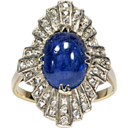 A Victorian Diamond and Sapphire Cabochon Ring Set in a 14KT Yellow Gold Band