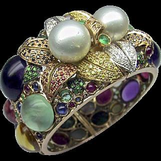 An Opulent 14KT Gold Gemstone and Pearl Bangle Bracelet
