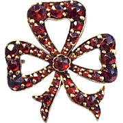 A Victorian Silver Gilt And Garnet Bow Brooch