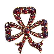 A Victorian Gold Filled And Garnet Bow Brooch