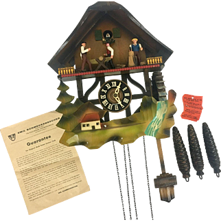 Vintage Schmeckenbecher Black Forest Series Sawmill Woodcutter Musical Cuckoo Clock made in West Germany with a Regula Movement 22 Comb Music Box Authenticated